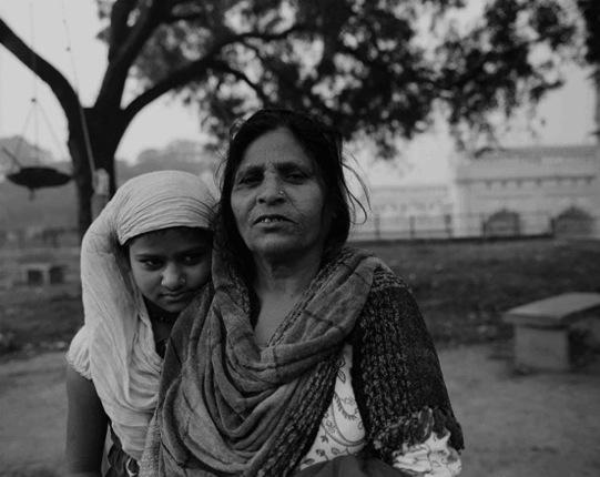 Migrant mother and daughter on the grounds of the Tile Wala Masjid